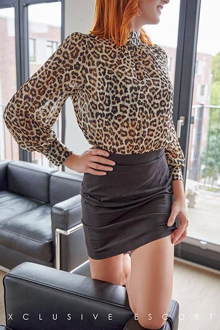 Escort Hanover Model Mia in elegance Dress. Perfect for an kinky Secretary Roleplay.