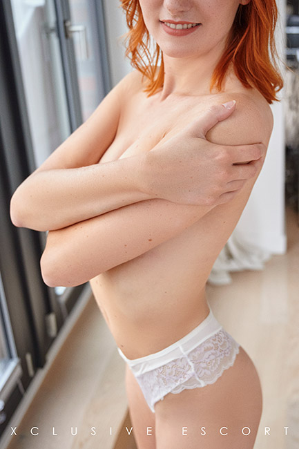 Escort Hannover Model Mia very natural in nice white Lingerie.