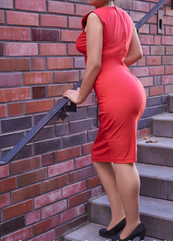 Escort Dame Maze by Escort Berlin in elegance red Dress.